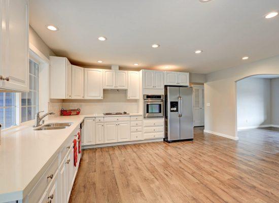New Light filled kitchen room boasts white cabinets, quartz countertops, subway tile backsplash and stainless steel appliances. Northwest, USA