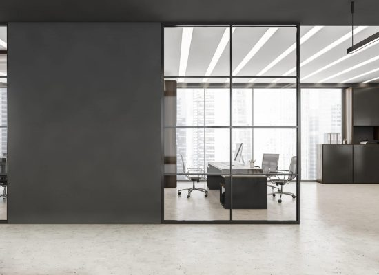 Black framed glass wall partitions with accent grey details, LED linear lights, concrete floor and workplace. A concept of modern office building. 3d rendering