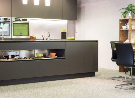 modern dark grey kitchen with illumination and sitting suite